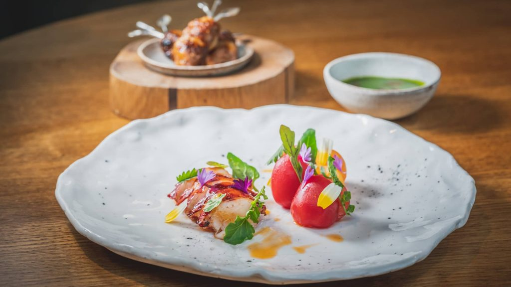 BBQ Cornish lobster tail and skewer with rosehip glaze and fermented green tomato sauce